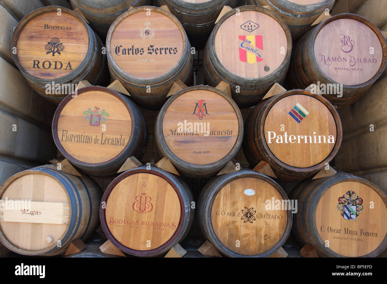 stack wine barrels. Stack Of Wine Barrels With Various Producers Names On Ends, Haro, La Rioja, Spain