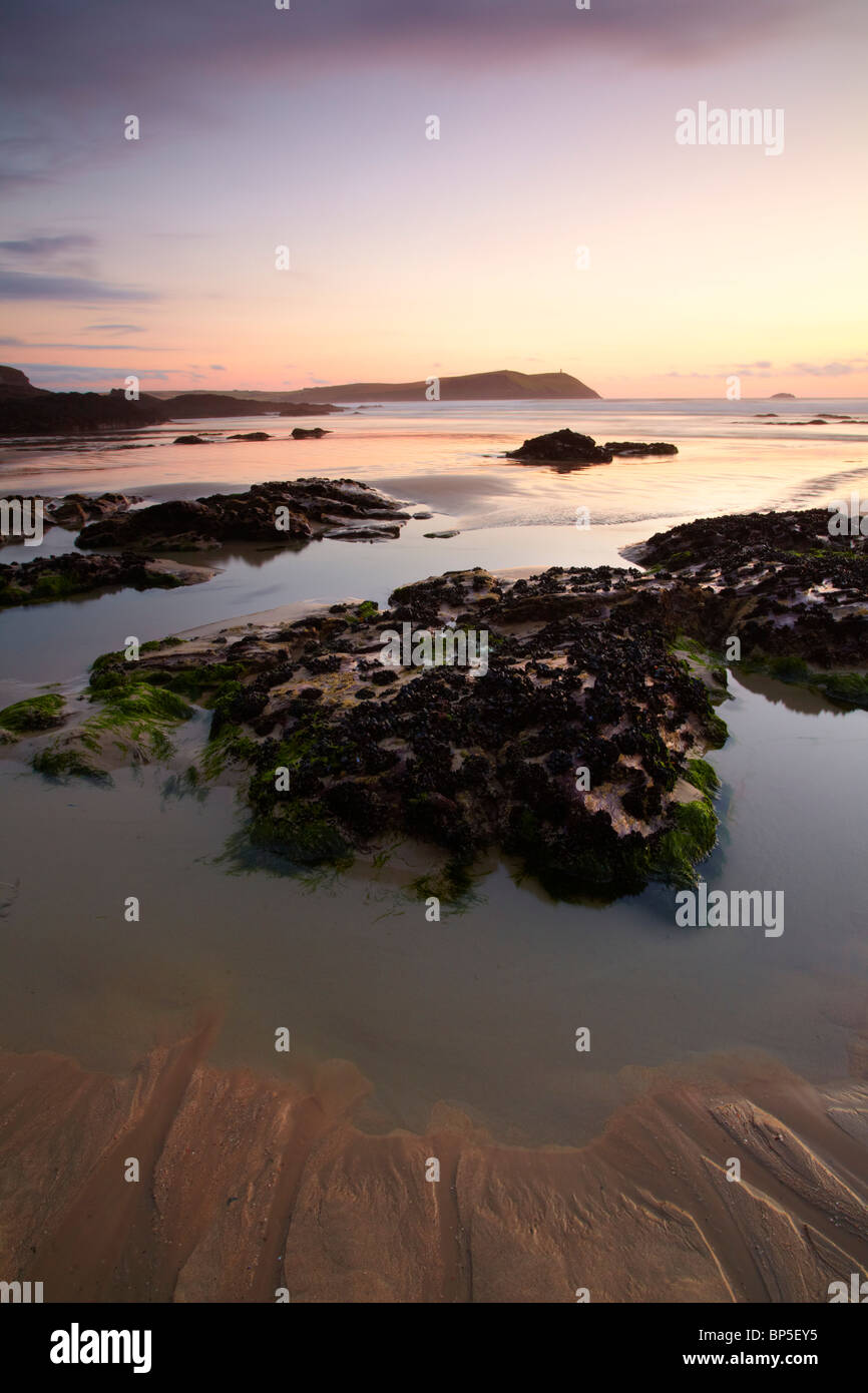 Dusk seascape from Polzeath beach looking towards Stepper Point at the mouth of the Camel estuary, North Cornwall. - Stock Image