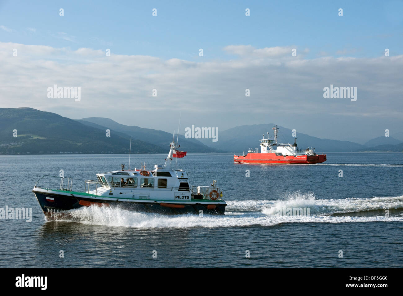 Clyde Port pilots ship Toward outside Gourock on the Firth of Clyde with Western Ferries car ferry Sound of Scarba - Stock Image