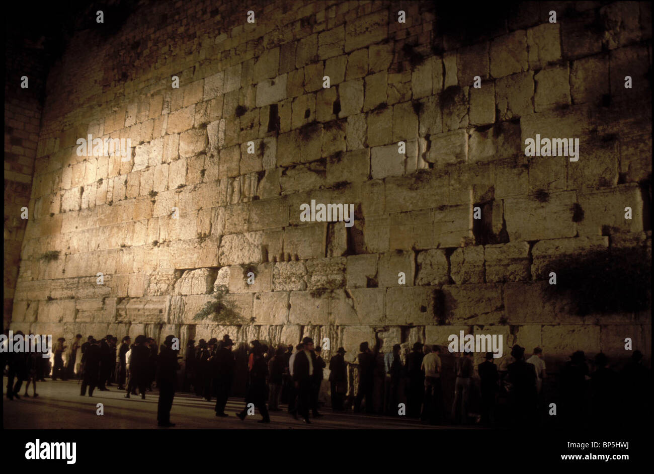 3363. PRAYING AT THE WESTERN WALL GOES ON UNINTERUPTED DAY AND NIGHT - Stock Image