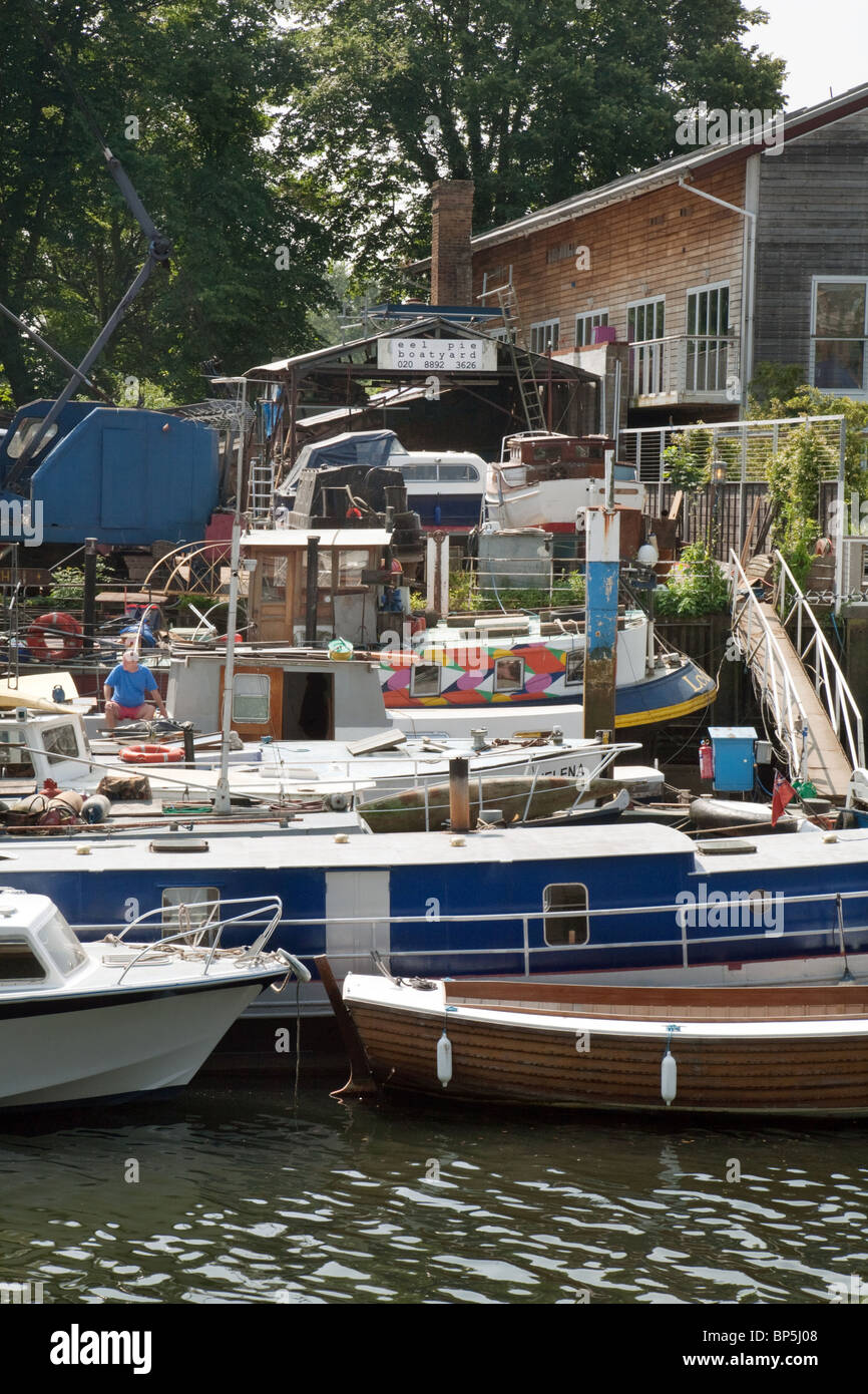 View of  the boatyard at Eel Pie island, the River Thames, Twickenham, London UK - Stock Image