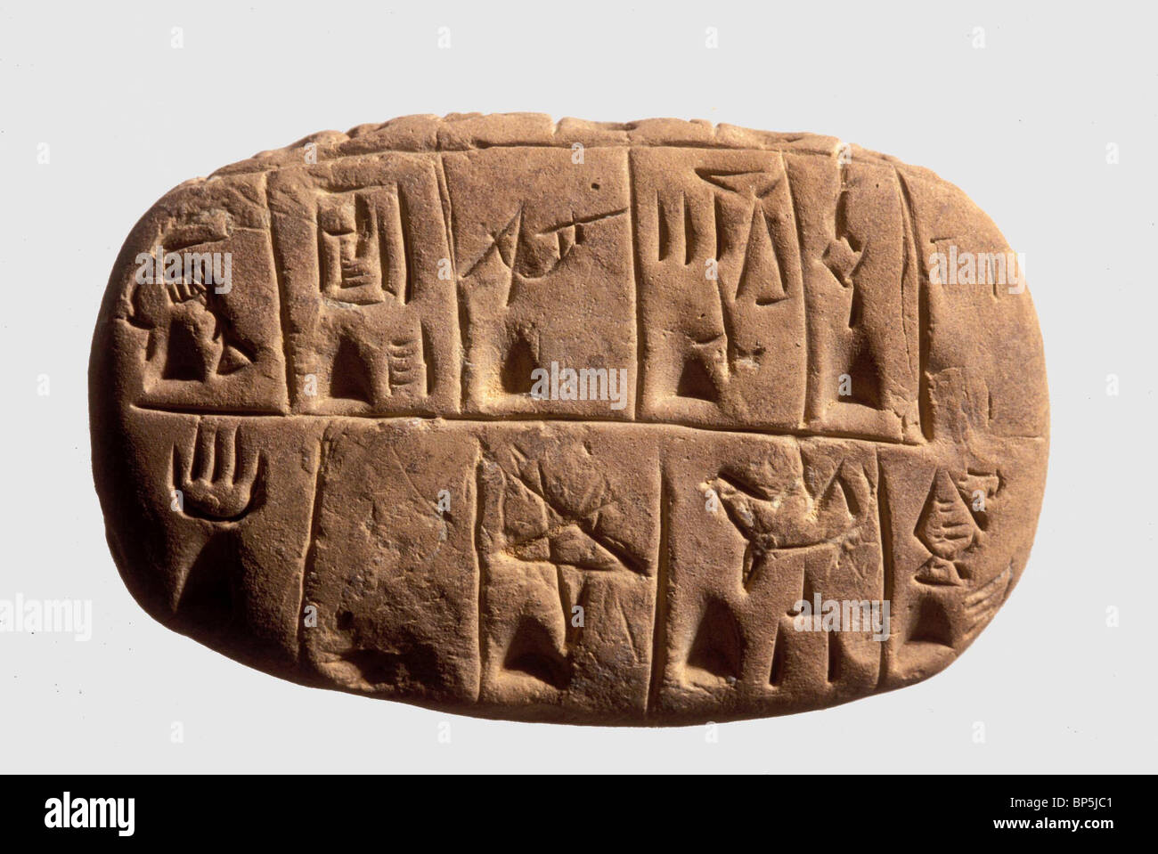 Clay tablet inscribed with an Archaic Pictographic script. Originating in Mesopotamia in the late fourth millenium - Stock Image