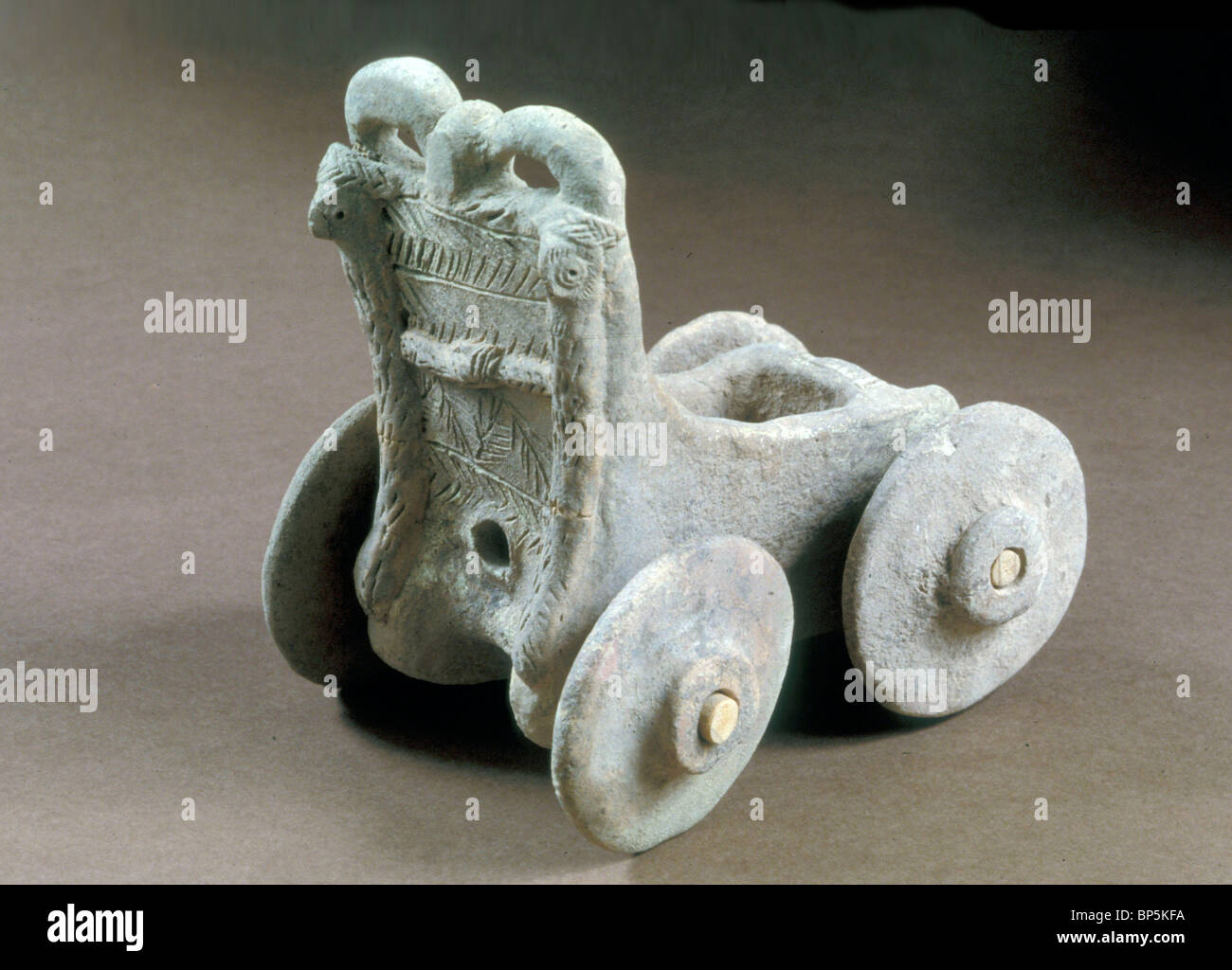 FOUR WHEELED TERRACOTTA MODEL OF A CHARIOT DEPICTS THE TYPE OF VEHICLE USED IN THE THIRD & EARLY SECOND MILLENNIUM - Stock Image