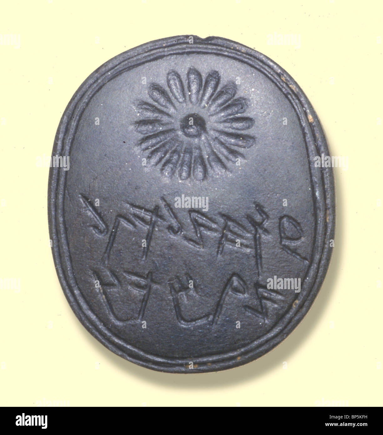 5185. HEBREW SEAL INSCR:' GE'ALIYAHU SON OF IMRI' DECORATED WITH A ROSETE. 7TH. C. BC - Stock Image