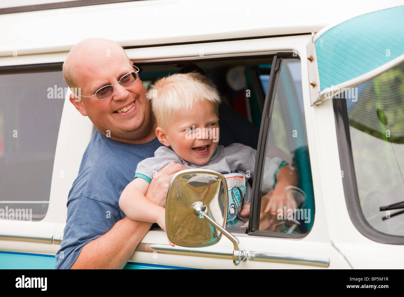 Fathers And Sons VW >> A Father And Son In An Old Restored Vw Camper Van Stock