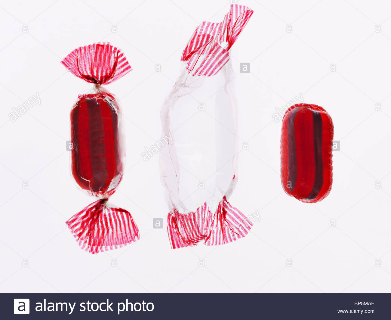 Wrapped and unwrapped hard candy - Stock Image