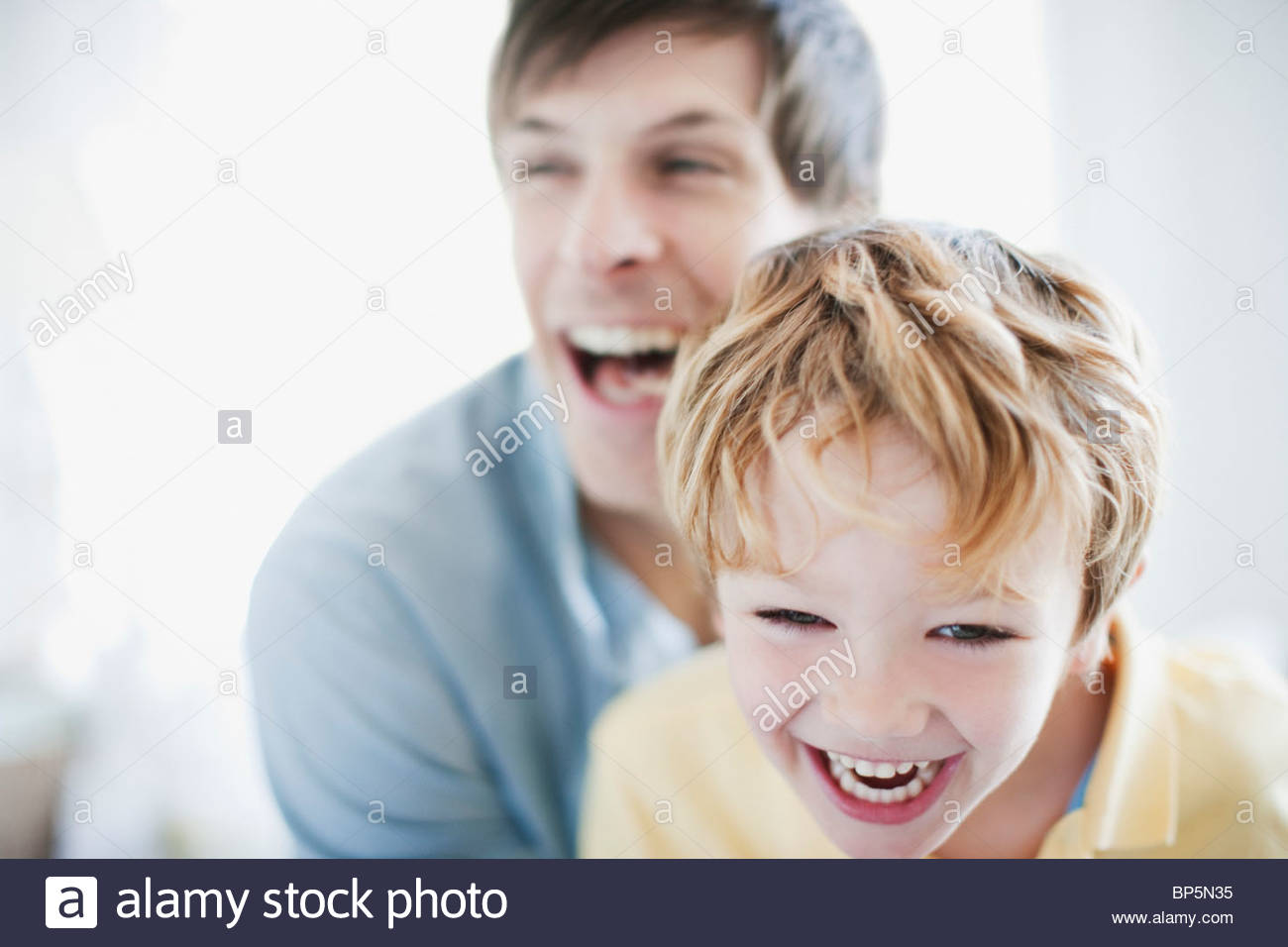 Father and son laughing - Stock Image