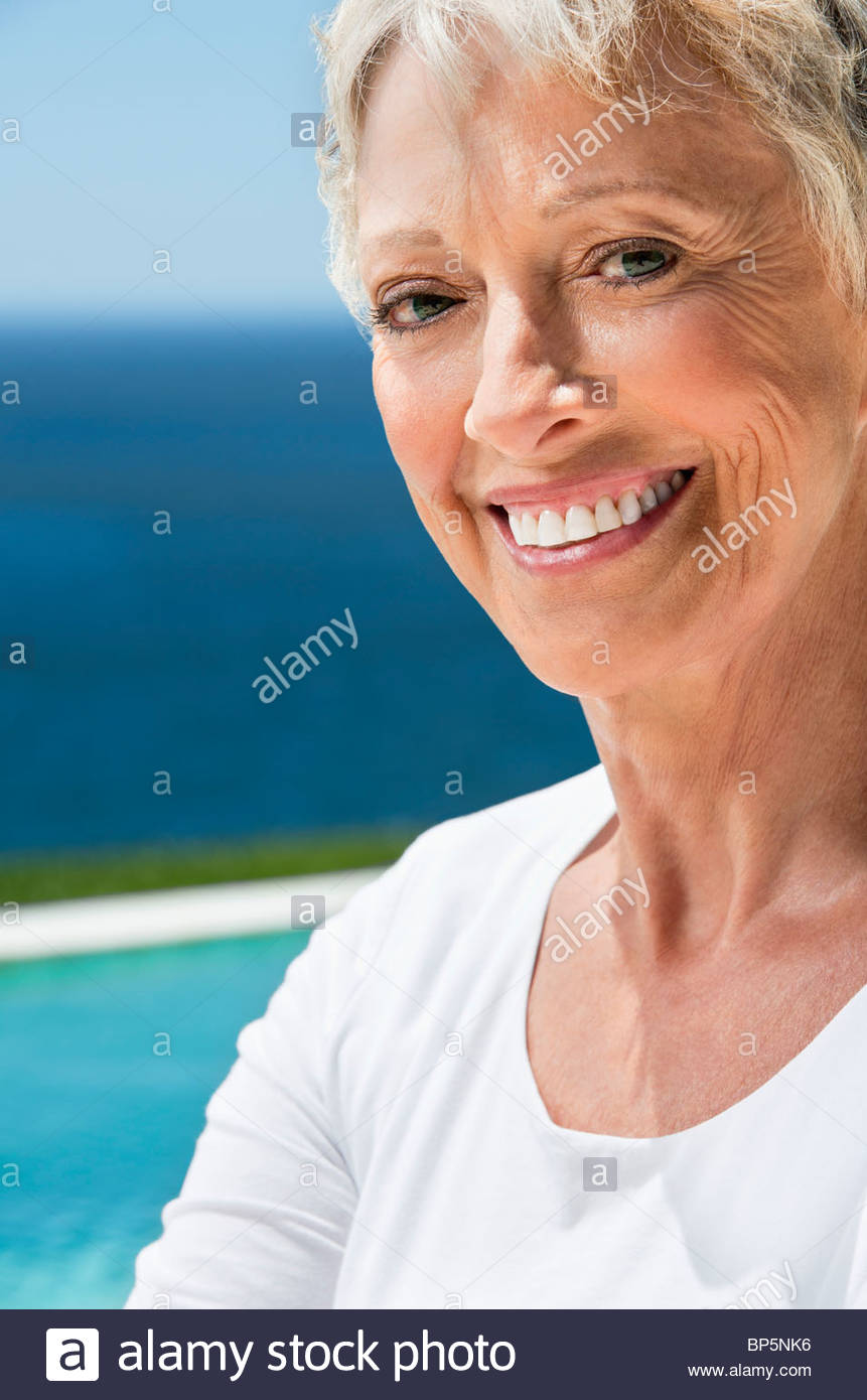 Close up of senior woman smiling - Stock Image