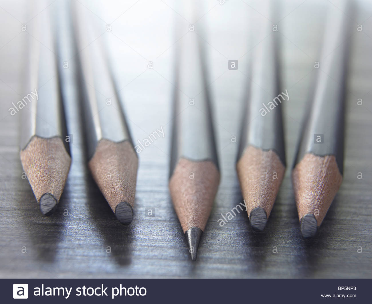 Close up of sharp pencil among dull pencils - Stock Image