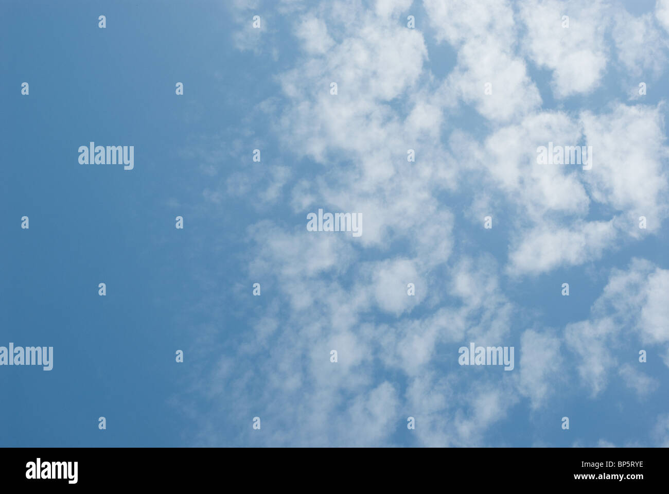 Blue sky and fluffy clouds - Stock Image