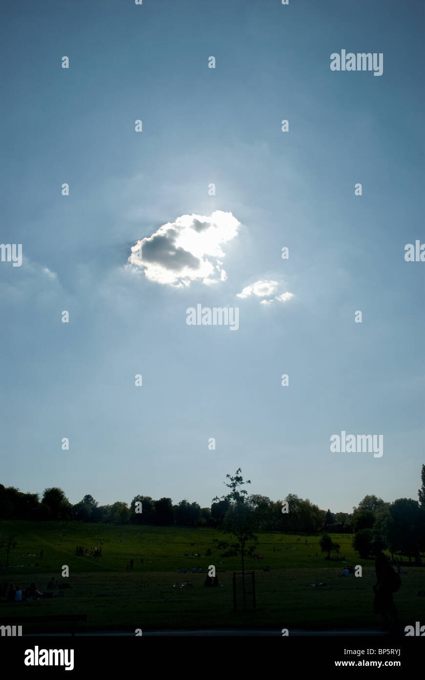 Cloud in front of sun - Stock Image