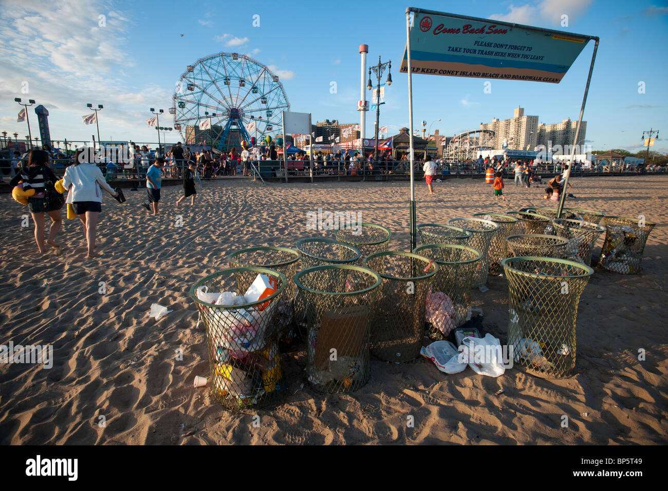 Trash cans on the beach at Coney Island in Brooklyn in New York on Saturday, August 14, 2010. (© Richard B. - Stock Image