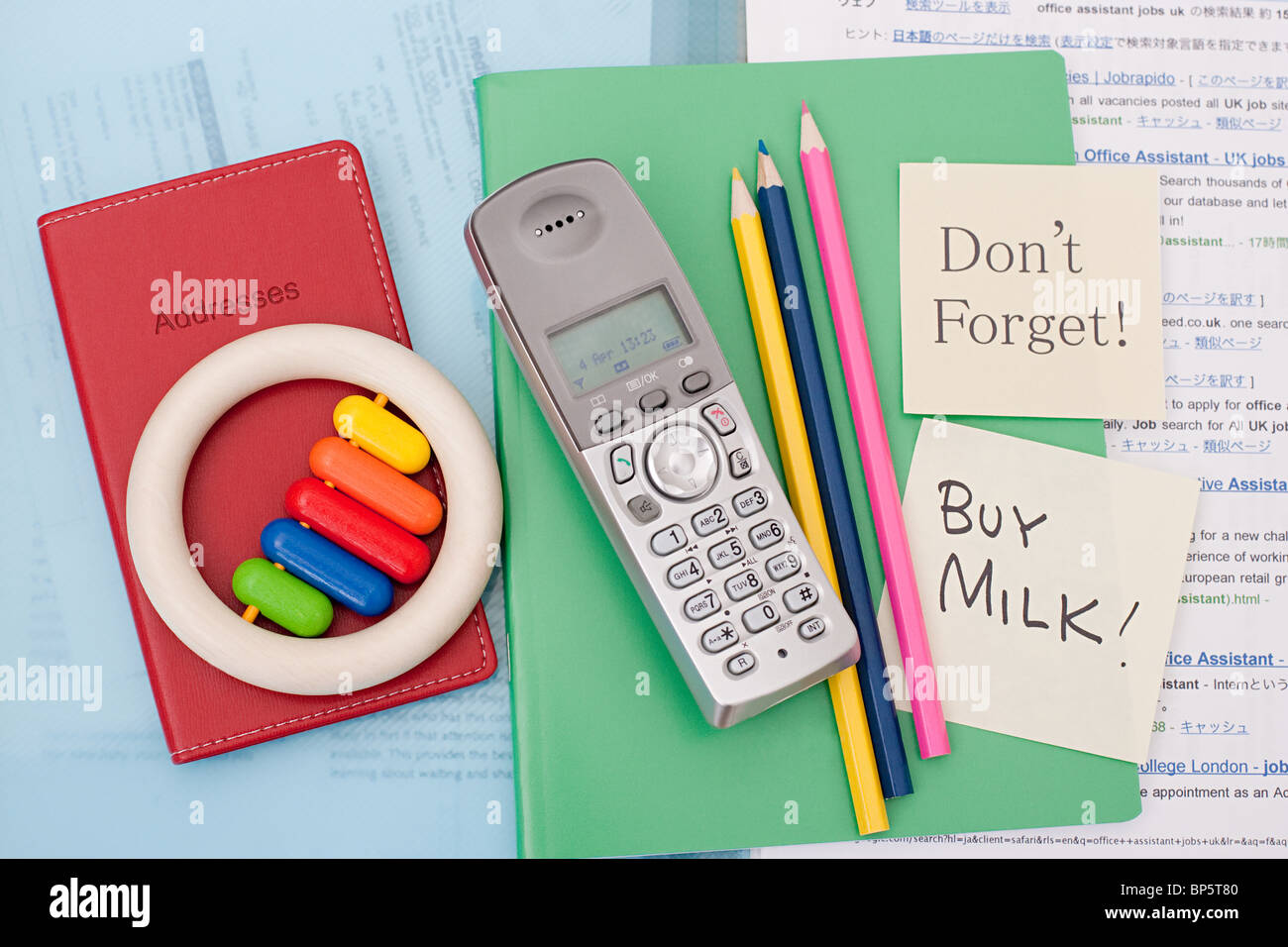 Reminder notes on parent's notebook - Stock Image