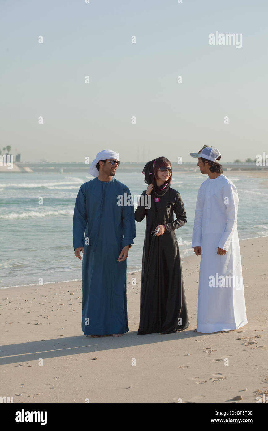 Middle Eastern people on the beach - Stock Image