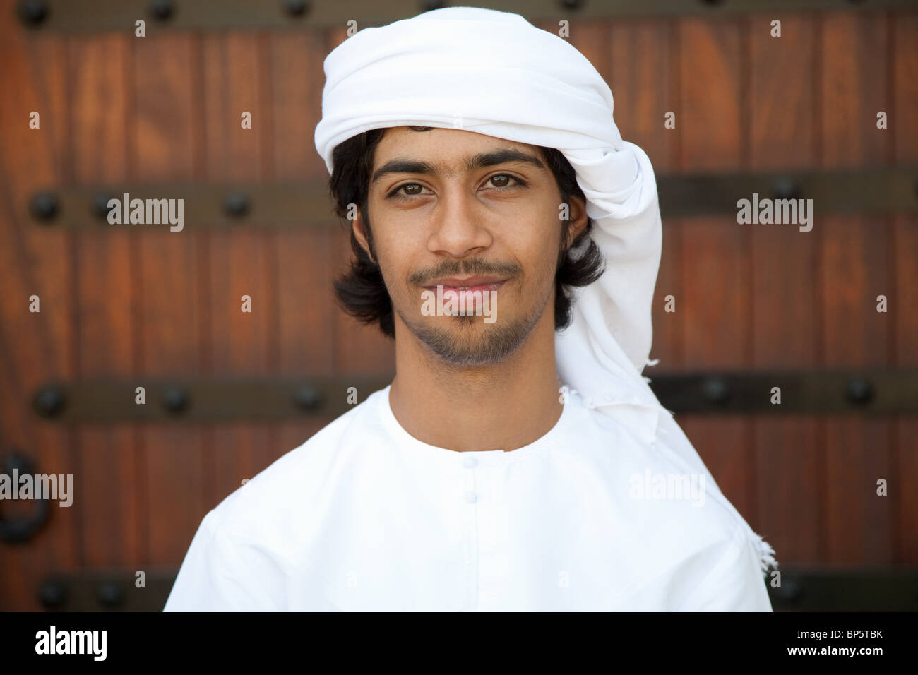 Middle Eastern man wearing headdress, portrait - Stock Image