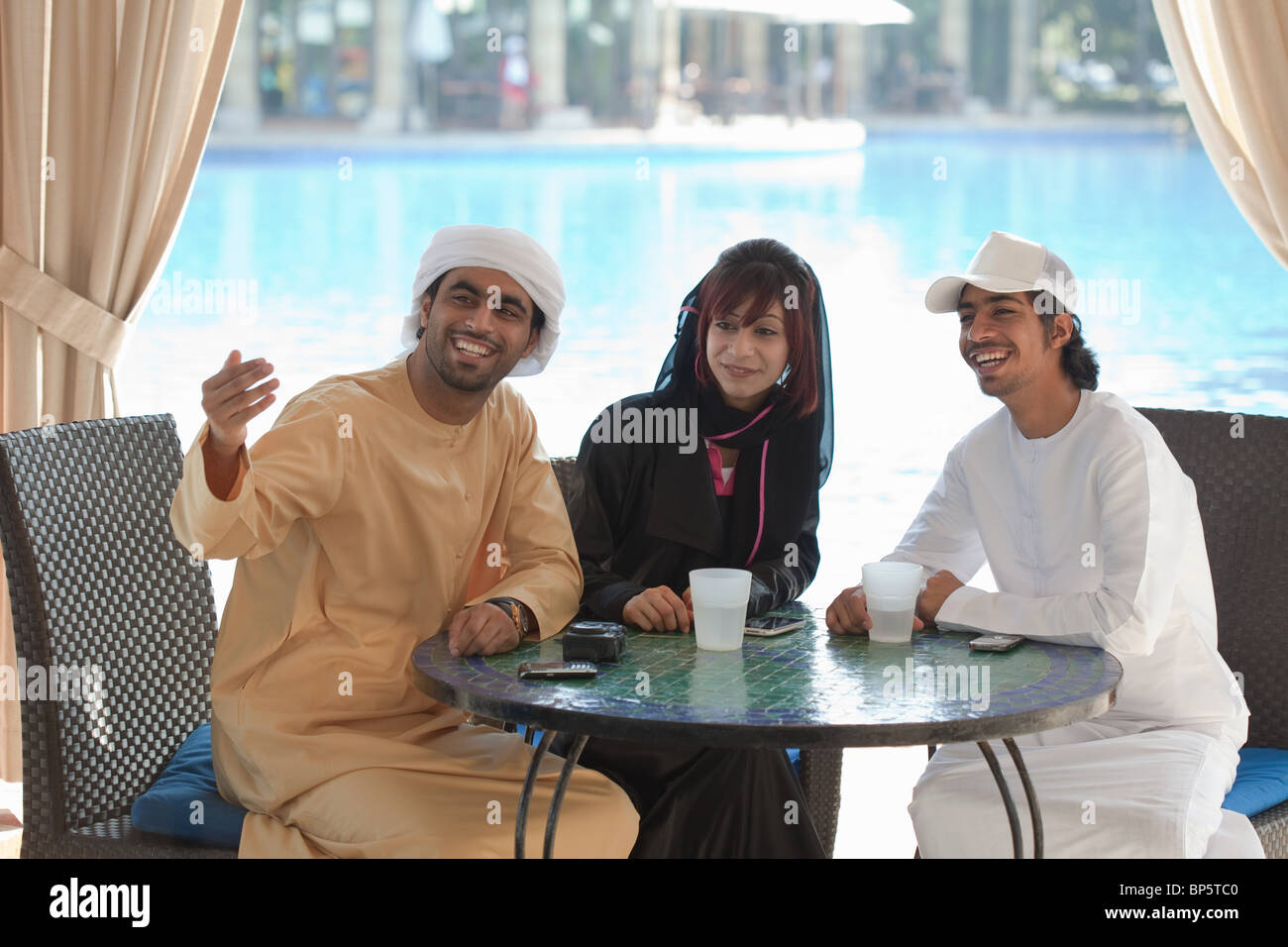 Middle Eastern people sitting at table outdoors - Stock Image