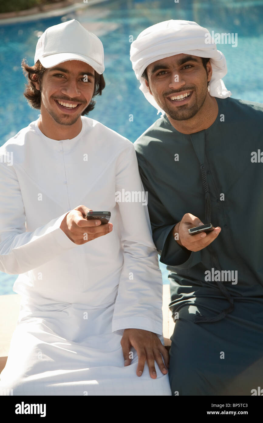 Two Middle Eastern men with mobile phones - Stock Image