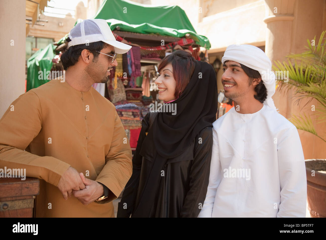 Middle Eastern people talking together - Stock Image