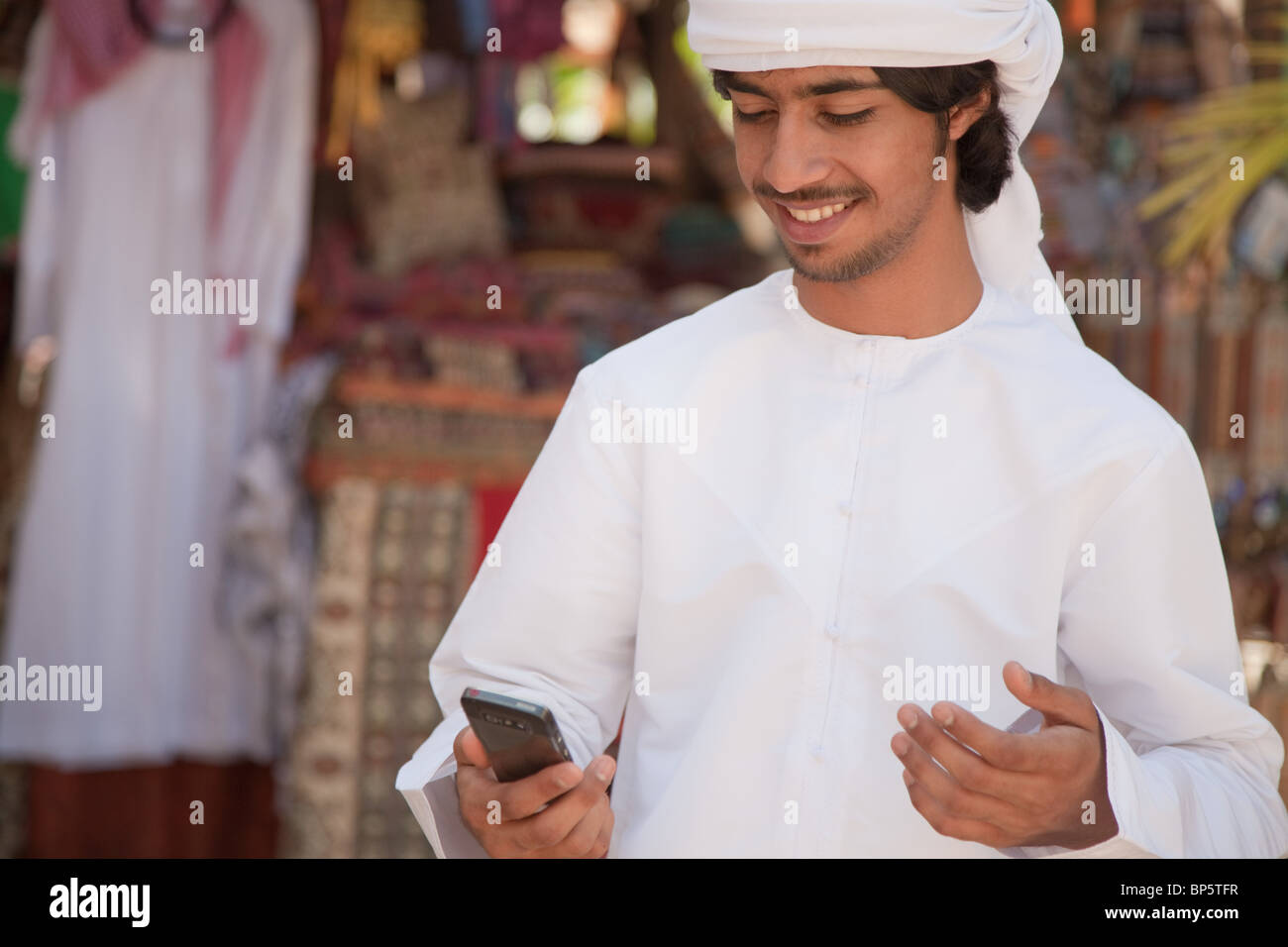 Middle Eastern man looking at mobile phone - Stock Image