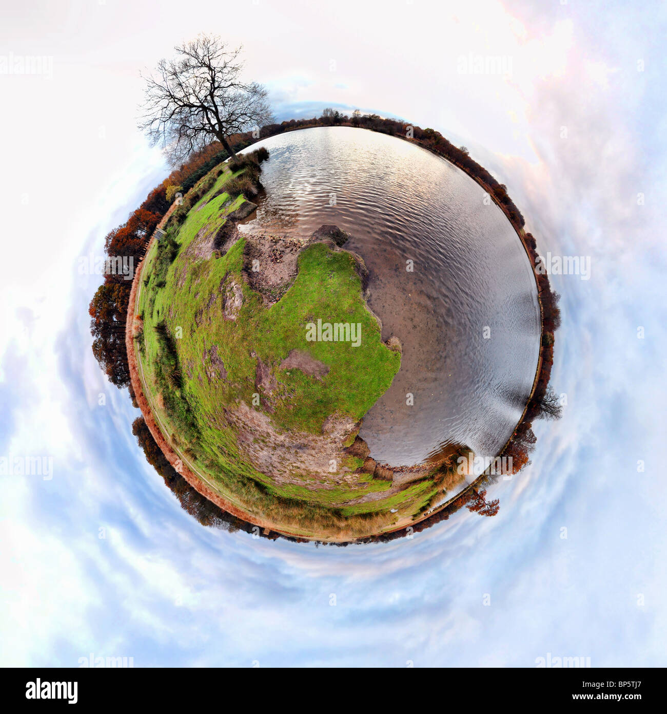 River and riverbank with little planet effect - Stock Image