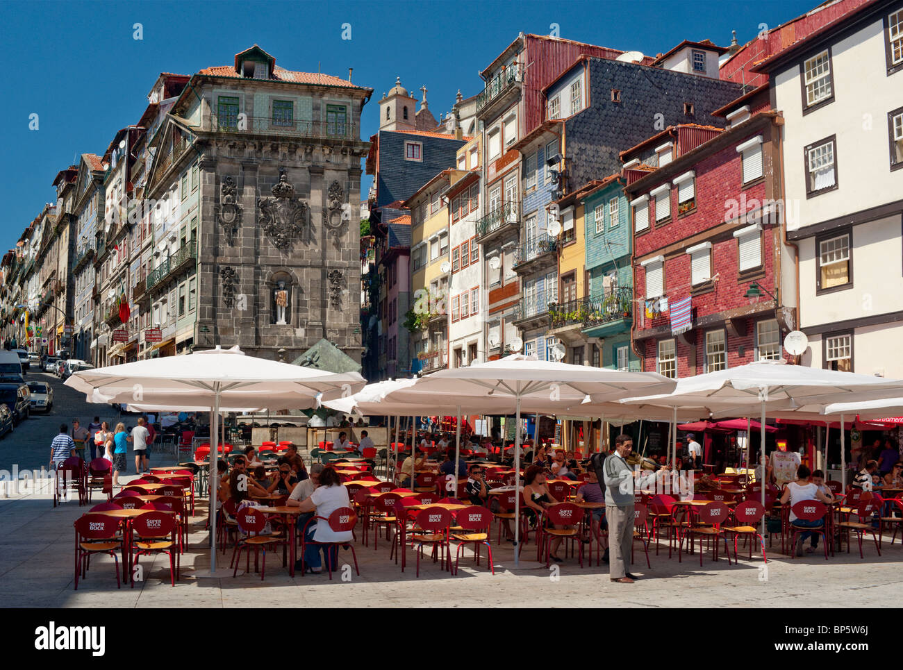 A street cafe in Oporto, Portugal. The Ribeira district - Stock Image