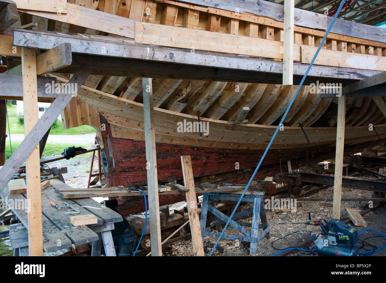 A Large Wooden Boat Being Restored Using Traditional Woodworking