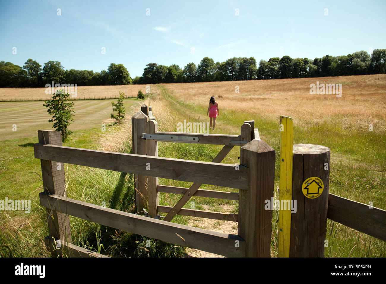 A young woman walking in the british countryside, Lyminge village near Folkestone, Kent, UK - Stock Image