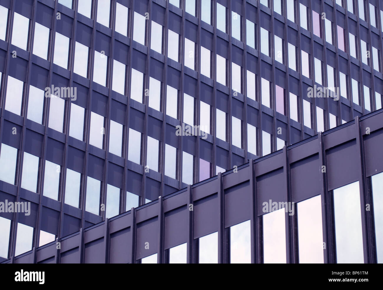 The exterior of a steel and glass office building - Stock Image