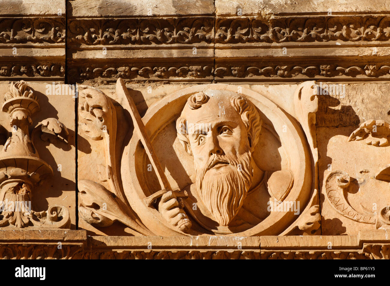 Salamanca university. Medallion of St Paul above the entrance to the courtyard of the Escuelas Menores - Stock Image