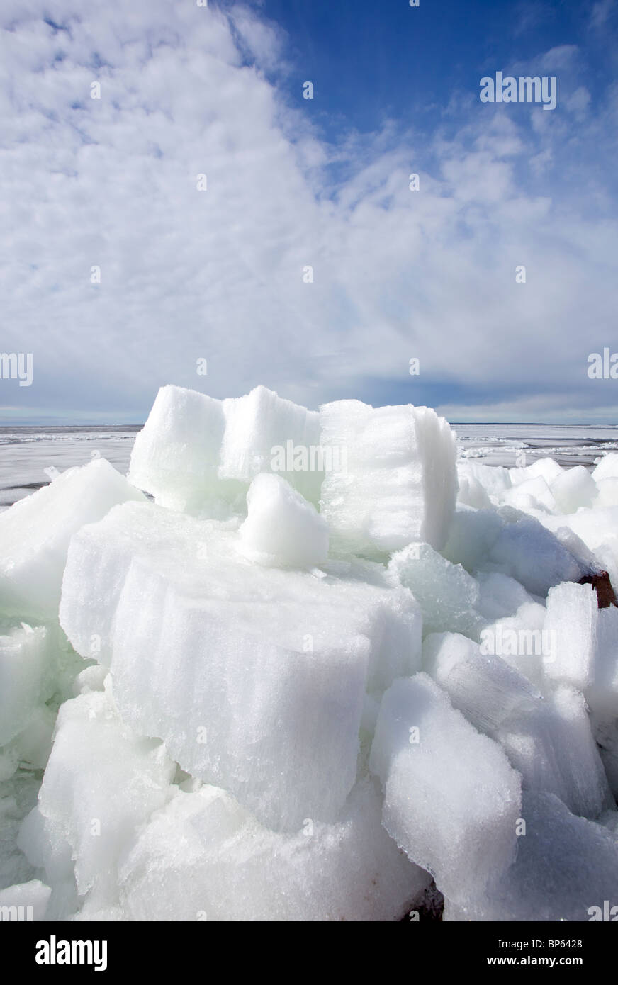 Melting ice blocks at seashore , Finland - Stock Image