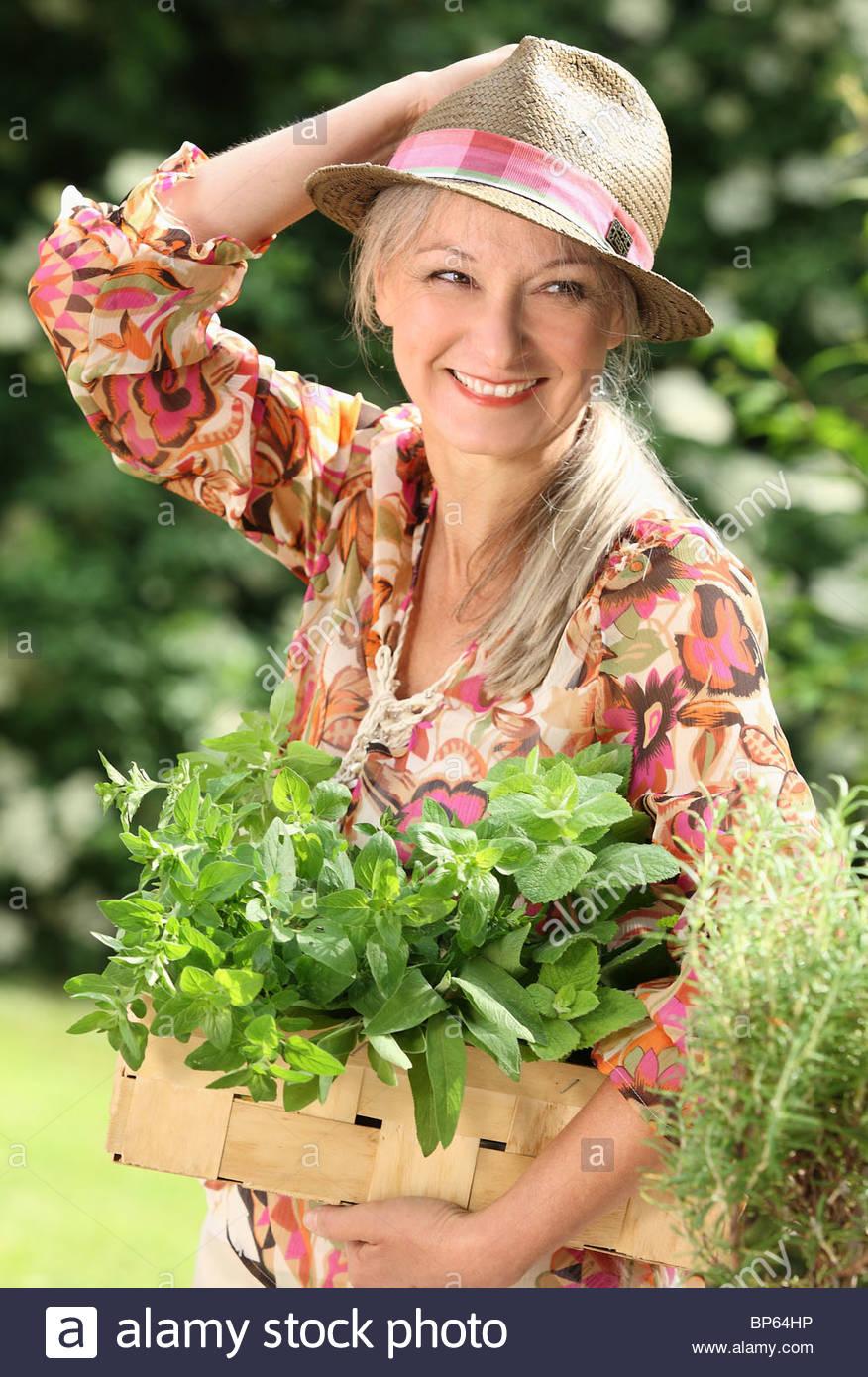 older woman picking fresh herbs Stock Photo: 30868146 - Alamy