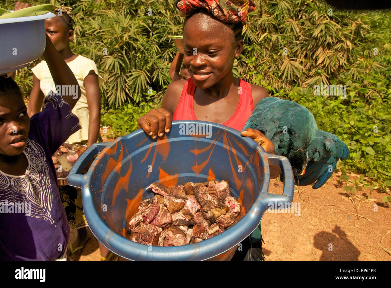 Liberian girl selling bushmeat - Stock Image