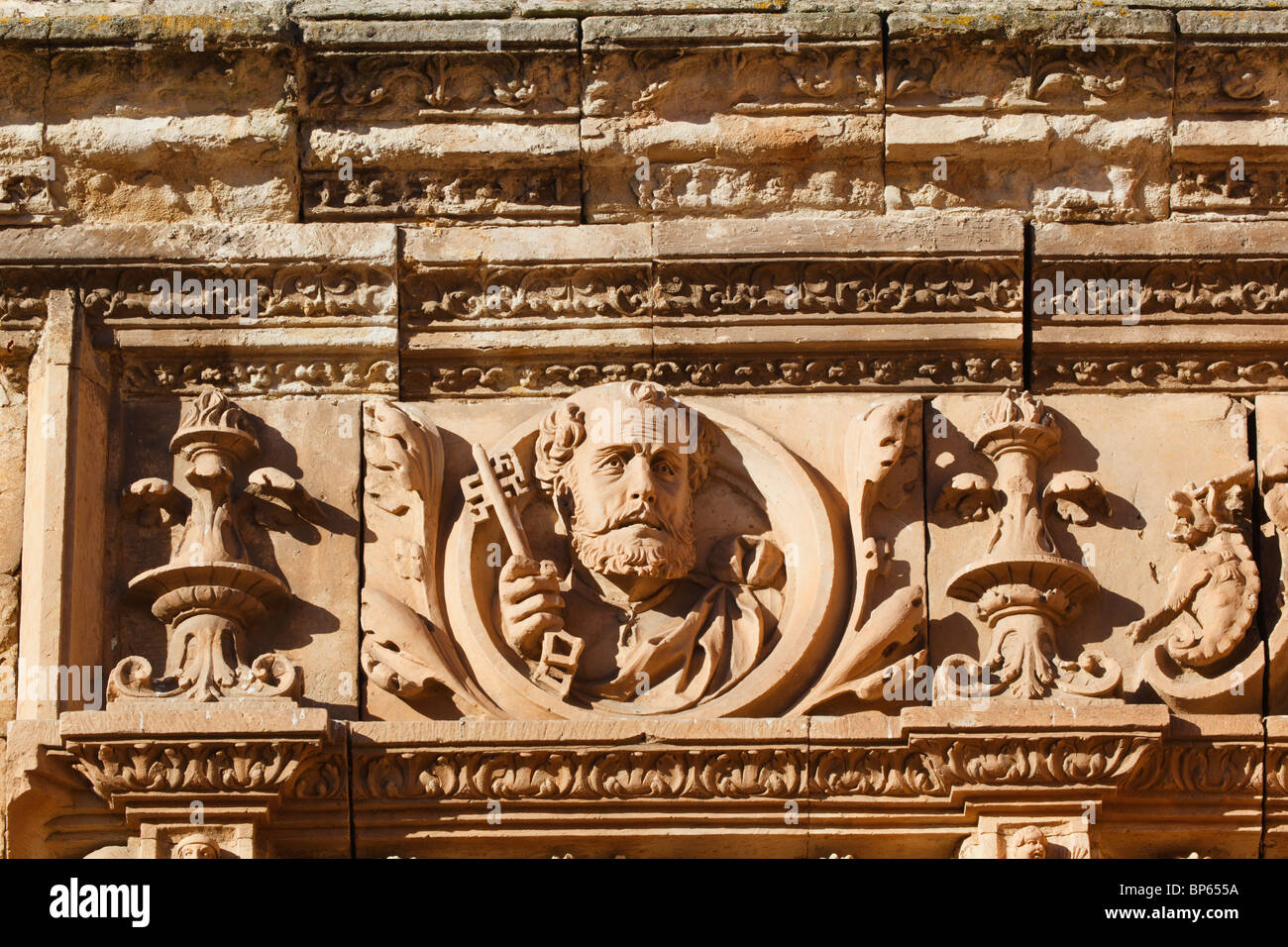 Salamanca university. Medallion of St Peter above the entrance to the courtyard of the Escuelas Menores - Stock Image