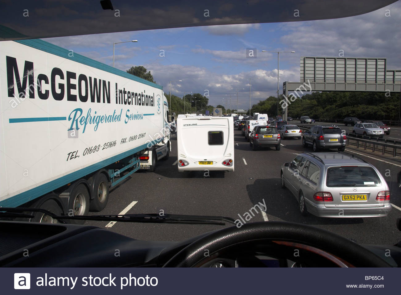 Lorry driver's view of traffic congestion on the M25 motorway, UK. - Stock Image