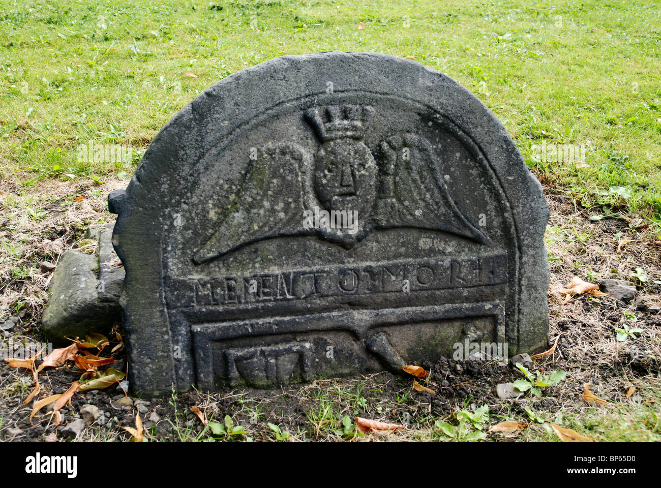 Headstone  with winged spirit and 'Memento Mori' inscription in Old Calton Burial Ground, Edinburgh. Stock Photo