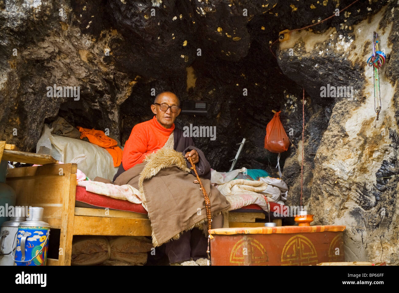 A religious hermit in his cave dwelling at Lake Namsto in Tibet. - Stock Image