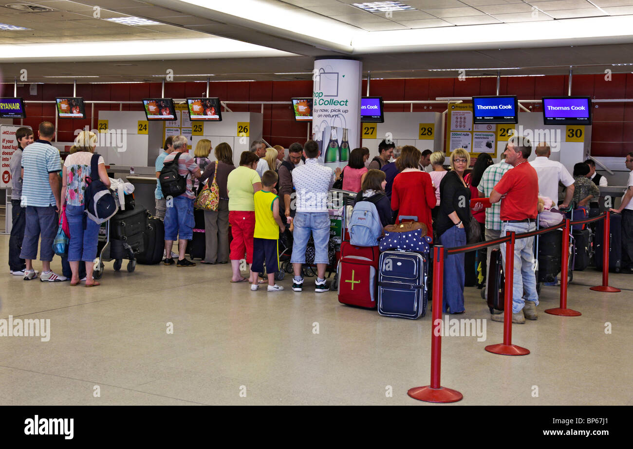 Queues of people (holidaymakers) at the Thomas Cook check-in desks at Edinburgh Airport, Scotland, UK, Great Britain Stock Photo
