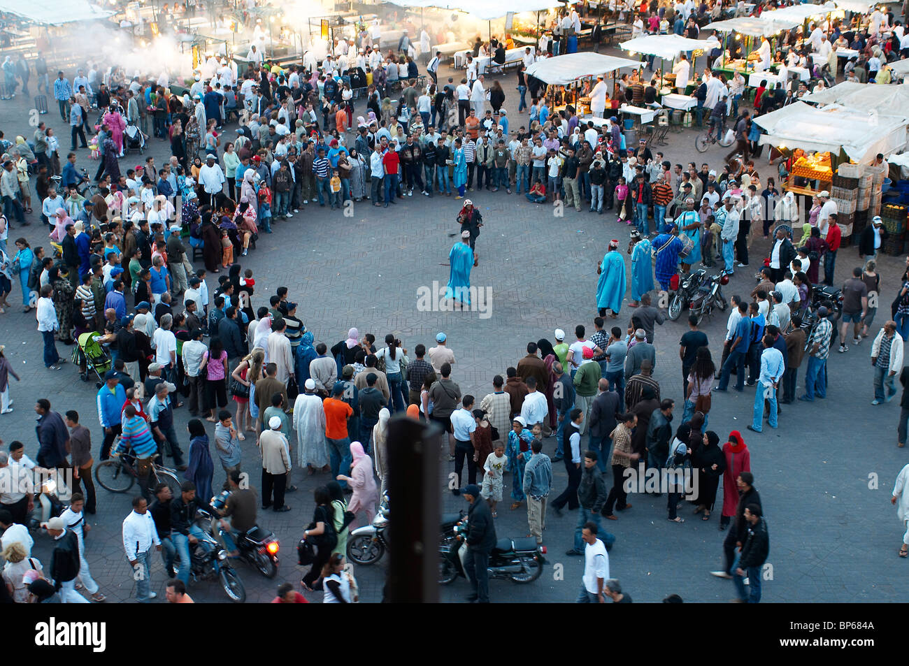Berber musicians and dancers gathering a crowd in the central market square of Jemaa El Fna in Marrakech Stock Photo