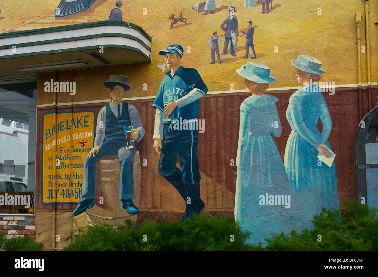 Painted wall mural showing victorian era life in the early 1900's, Blue Lake, Humboldt County, California - Stock Image