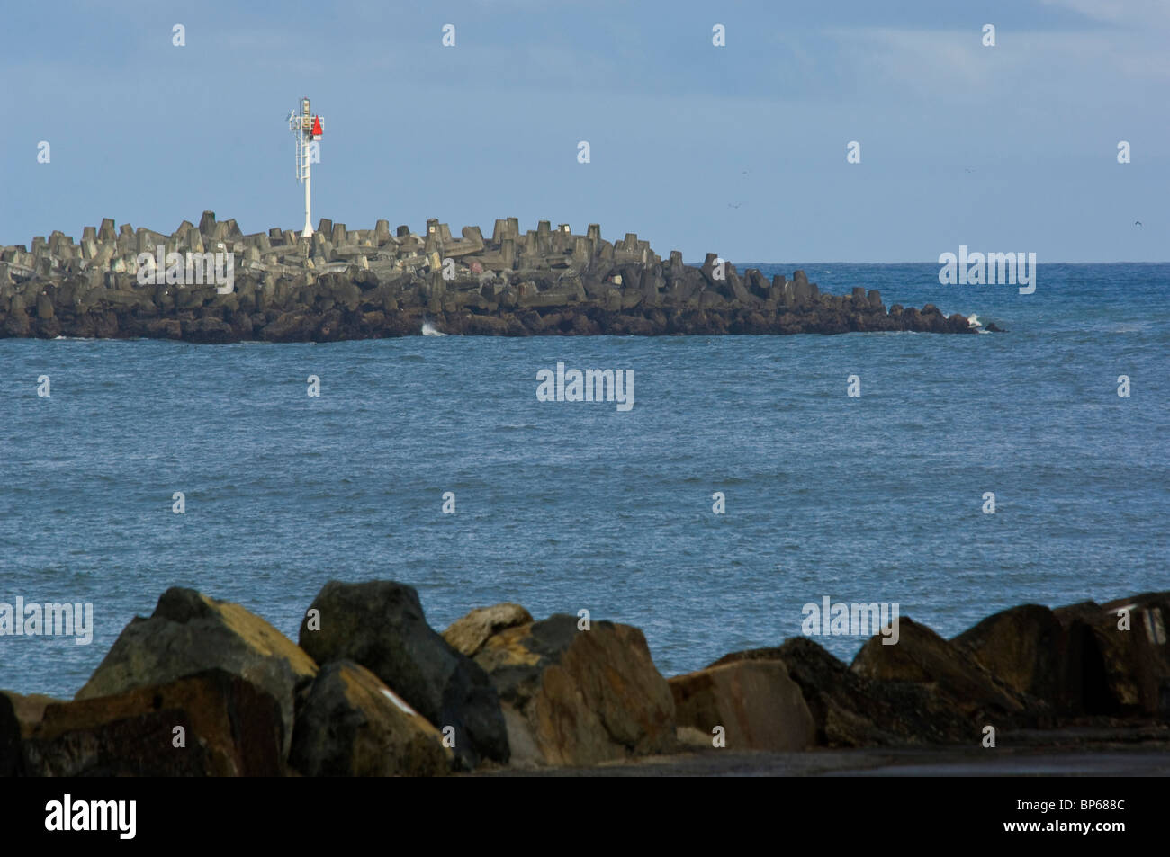 Red Harbor Entrance Marker on the South Jetty, at the channel into Humboldt Bay, California Stock Photo