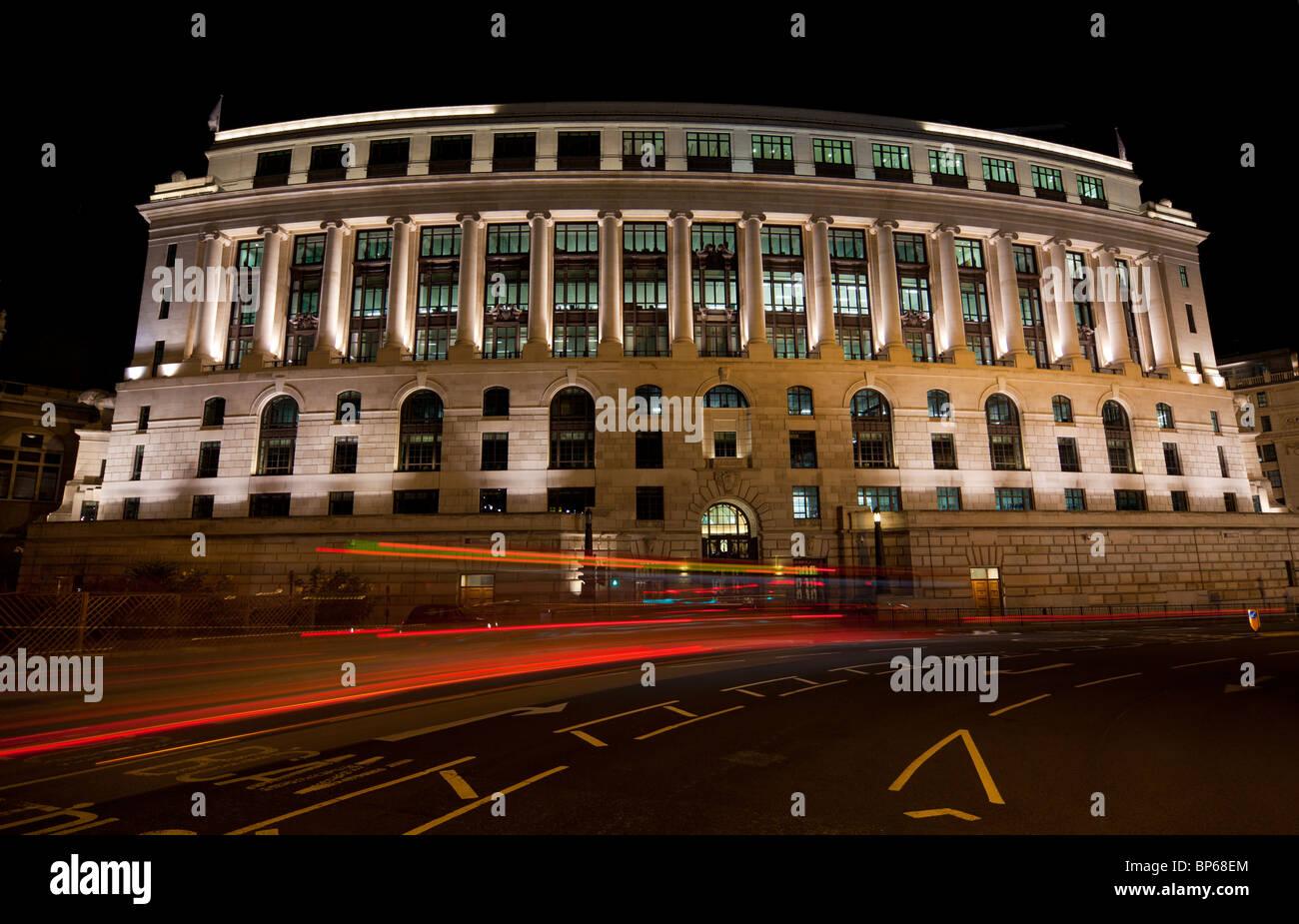 Unilever House, headquarters of Unilever at night, London, UK. - Stock Image