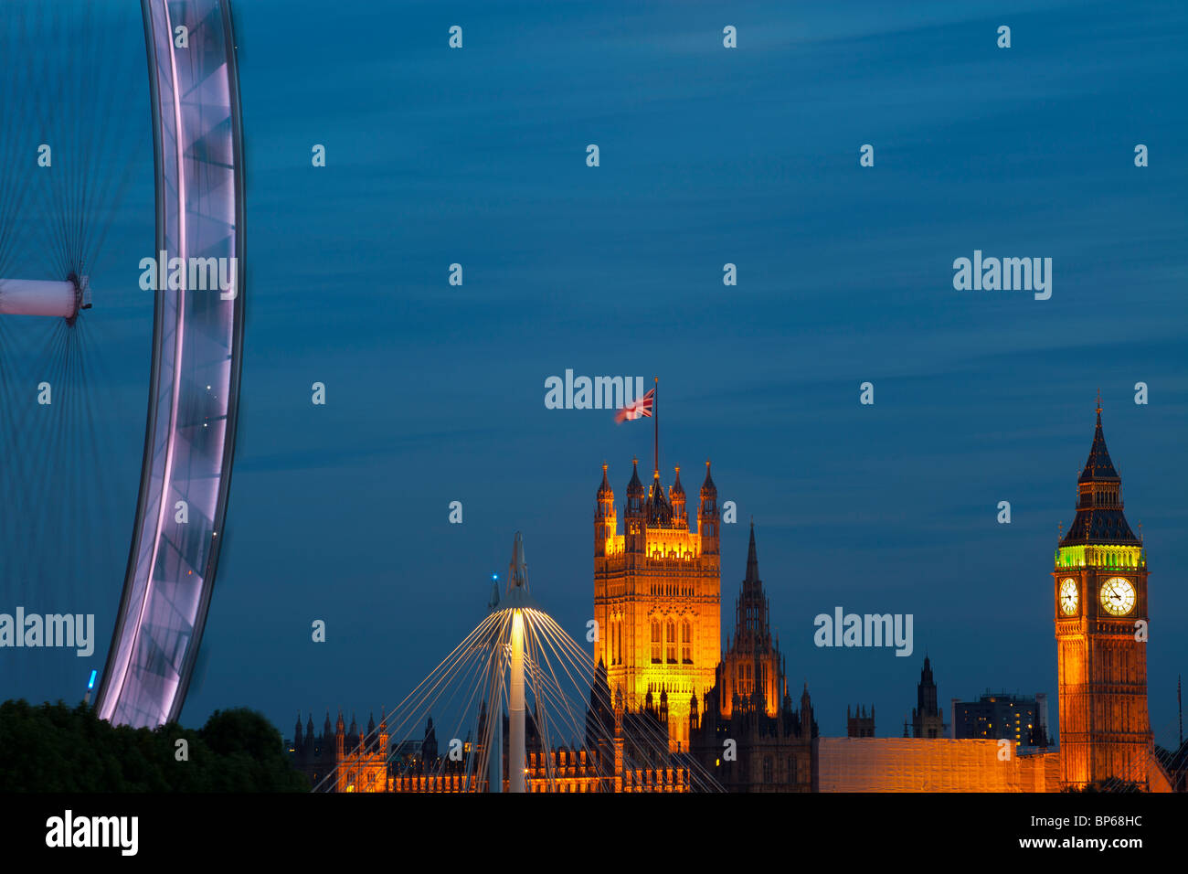 Millennium wheel and Houses of Parliament at dusk, London, UK. - Stock Image