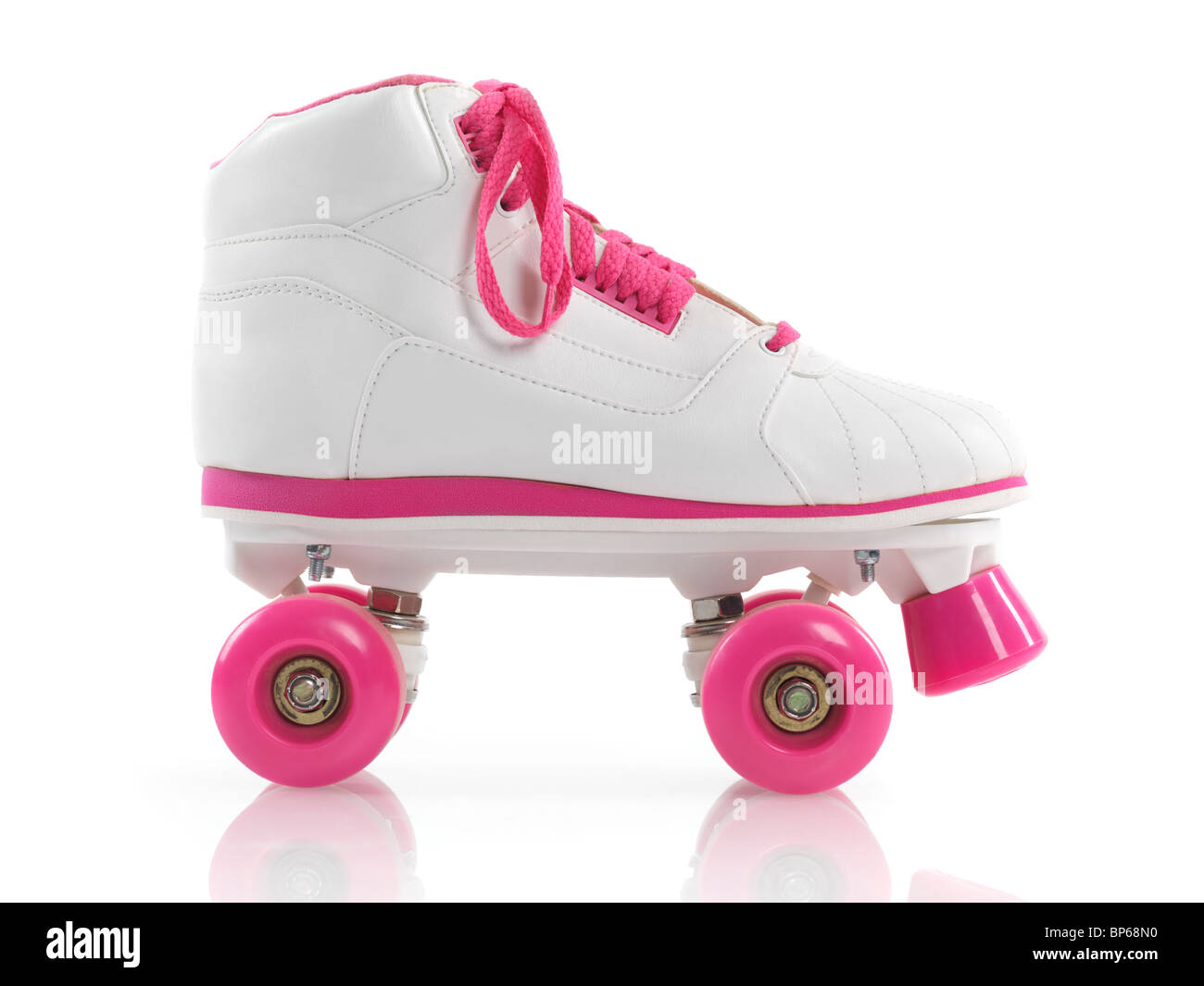 White with pink classic roller girl derby skate isolated on white background - Stock Image
