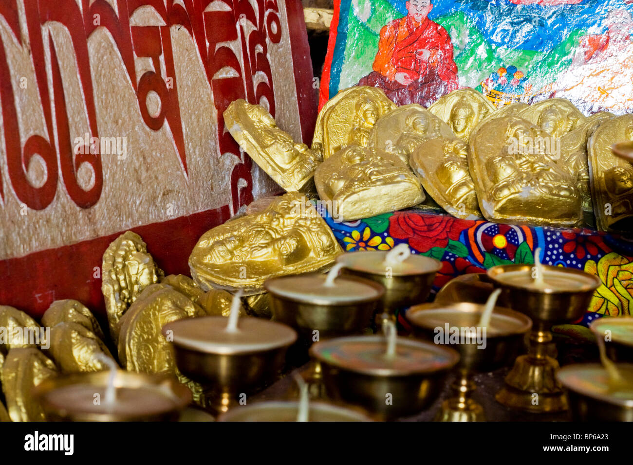 A collection of Buddhist items in a hermits cave near Lake Namsto, Tibet - Stock Image
