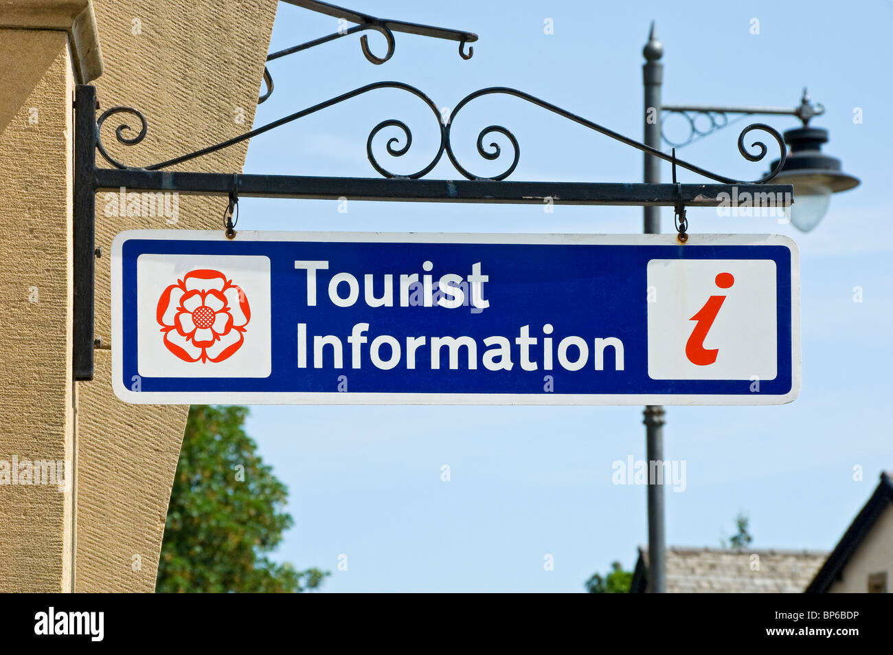 Tourist information sign hanging on wall outside visitor centre Cumbria England UK United Kingdom GB Great Britain - Stock Image
