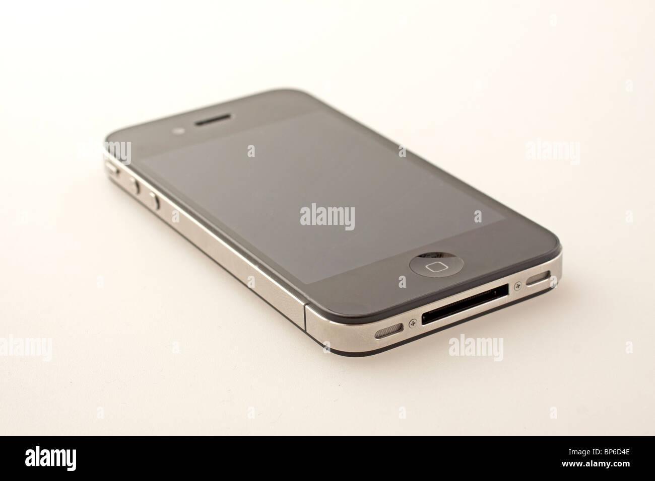 Brand new iPhone 4 over gray/white background Stock Photo