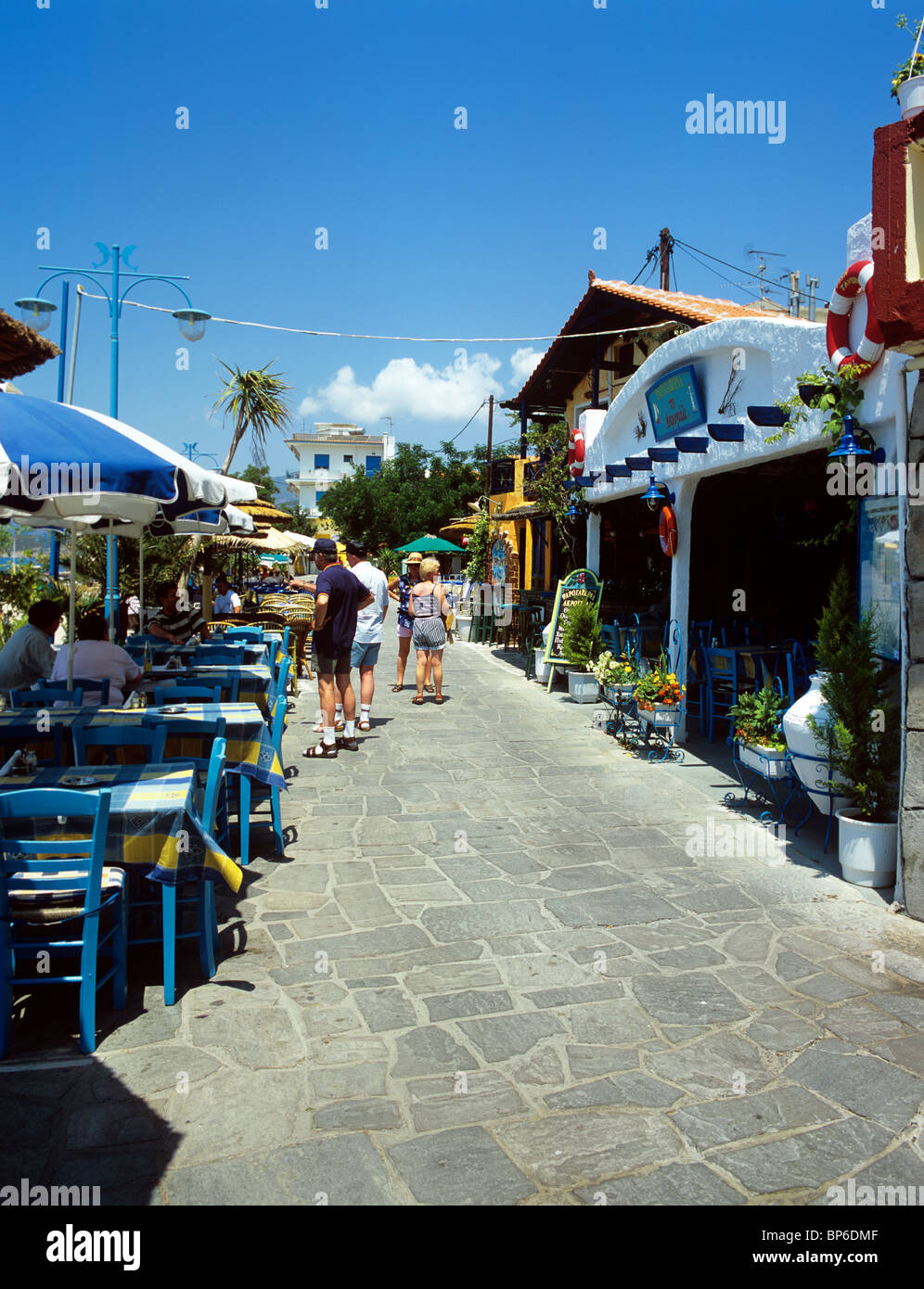 Tavernas line the promenade in the picturesque resort of Potos on ...