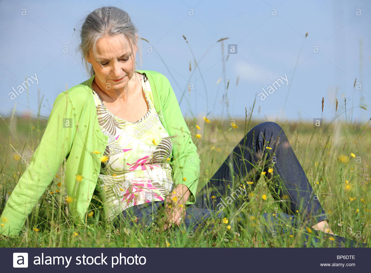 woman relaxing on meadow Stock Photo