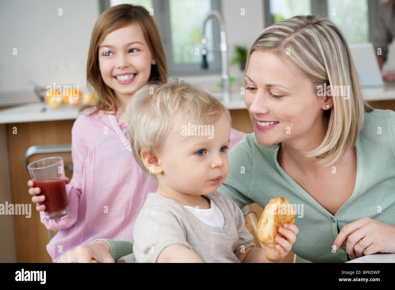 Family at a breakfast table - Stock Image