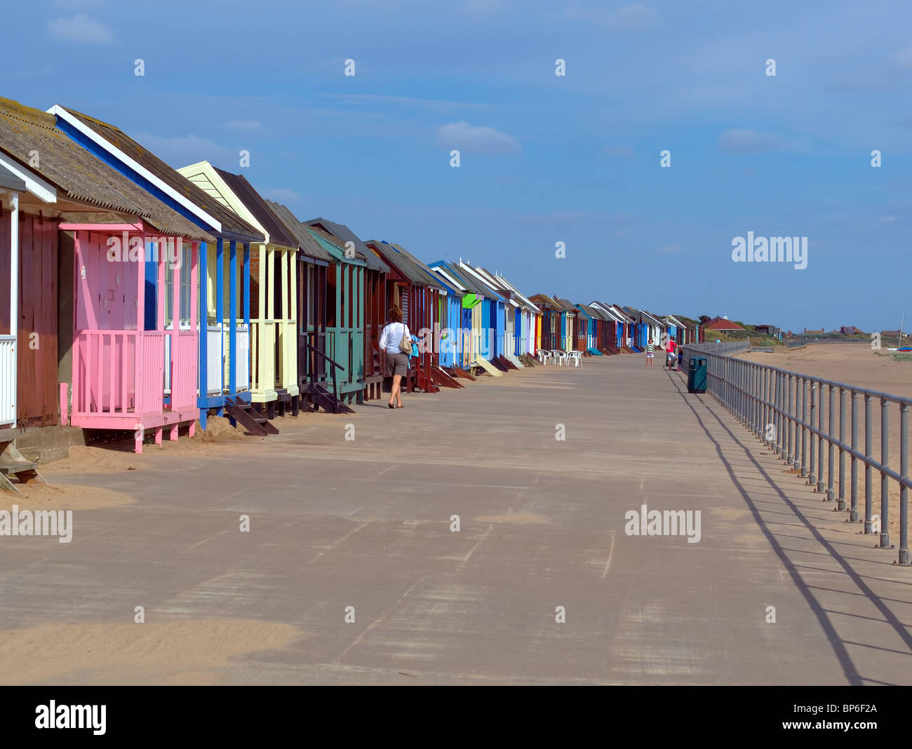 Rows of beach huts on the promenade at Sandilands,Sutton-on-sea,Lincolnshire, UK. - Stock Image